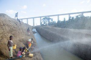 Mazeras In Mombasa Bridge Kids Fetching Water