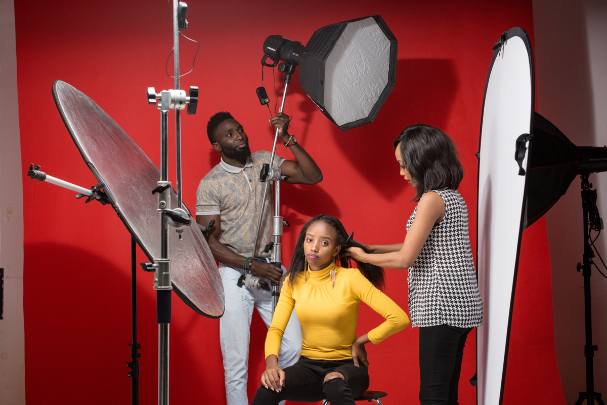 Frederick Dharshie Wissah assisting with the light on the Hezena Lemaletian Lifestyle Studio Portraits