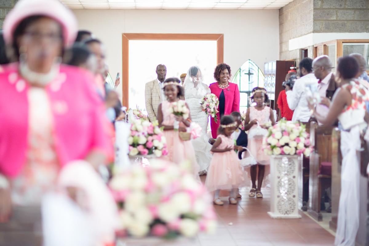 Bride walking down the aisle at PCEA Nairobi West Church