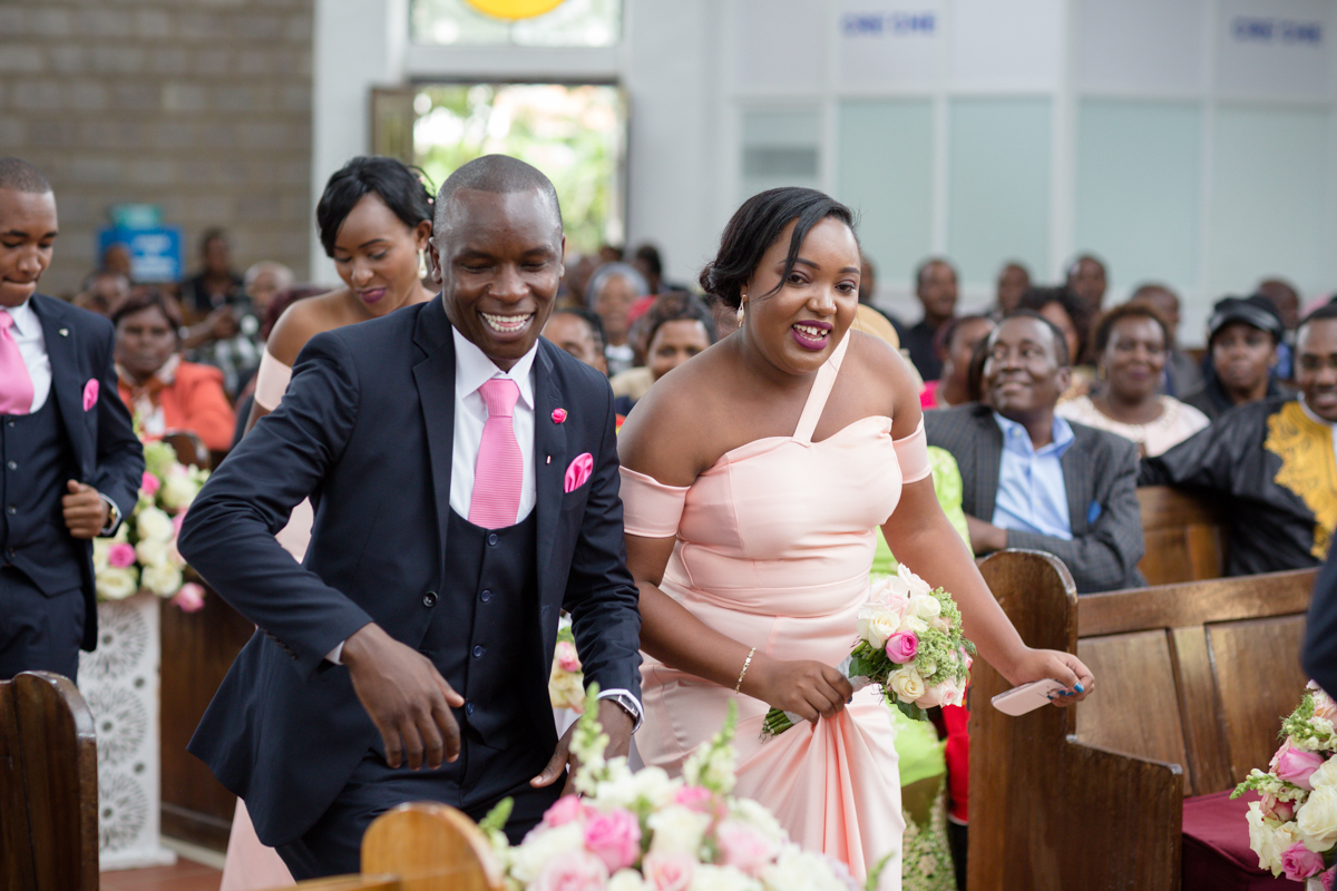 Bridesmaids walking down the aisle at PCEA Nairobi West Church
