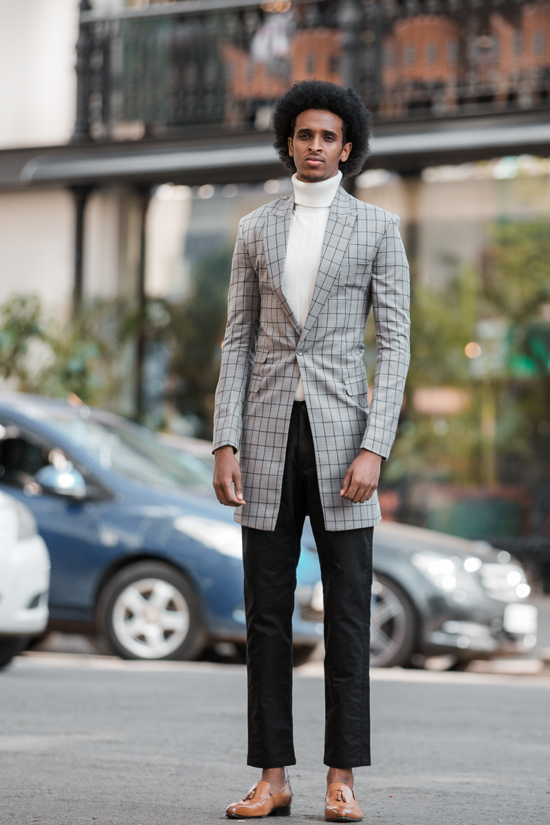 Lugo Collection dresses Gigi Habib also known as Mr. Xabib outside CJ's Restaurant Breakfast & brunch Nairobi