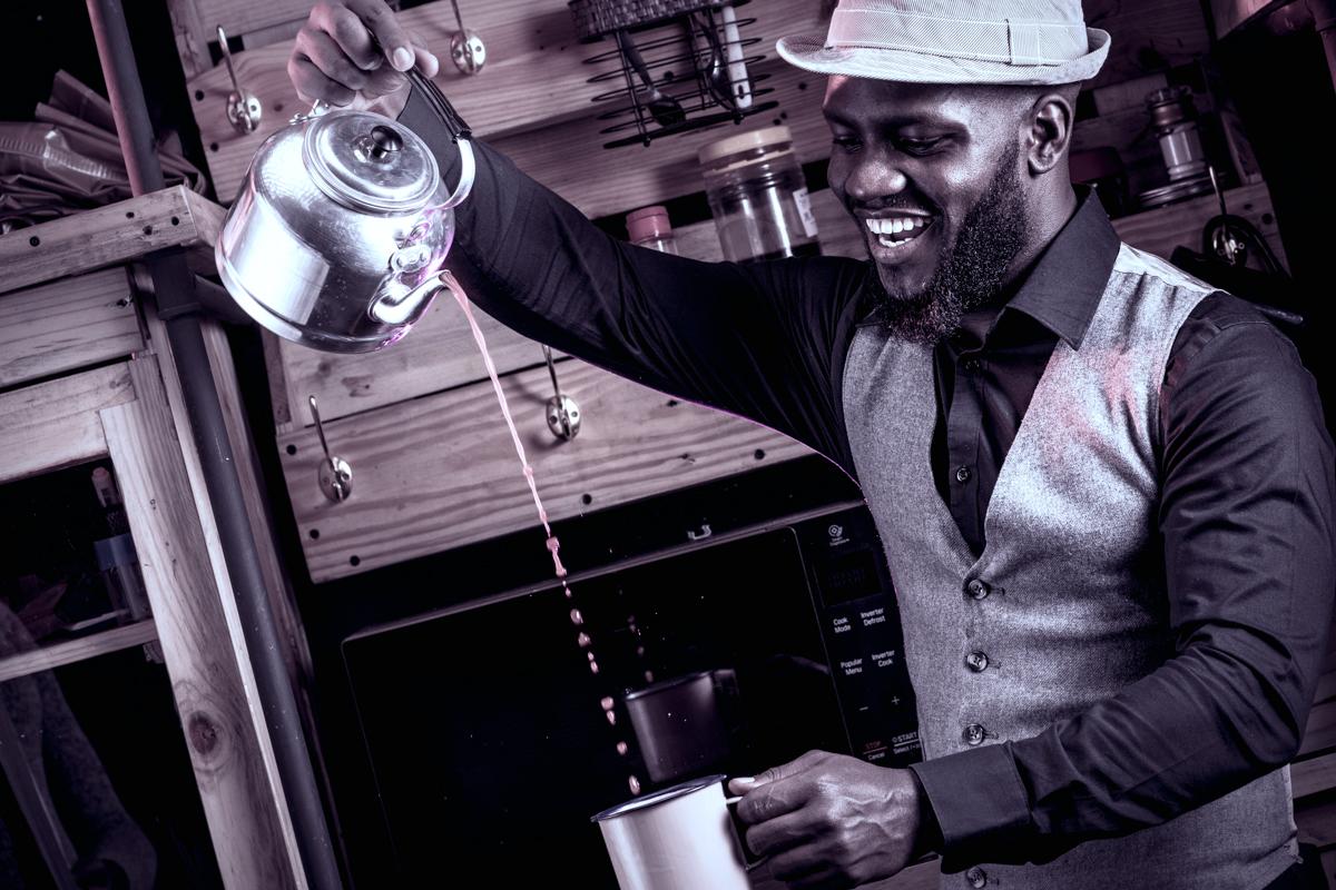Isaya Evans having fun with african tea
