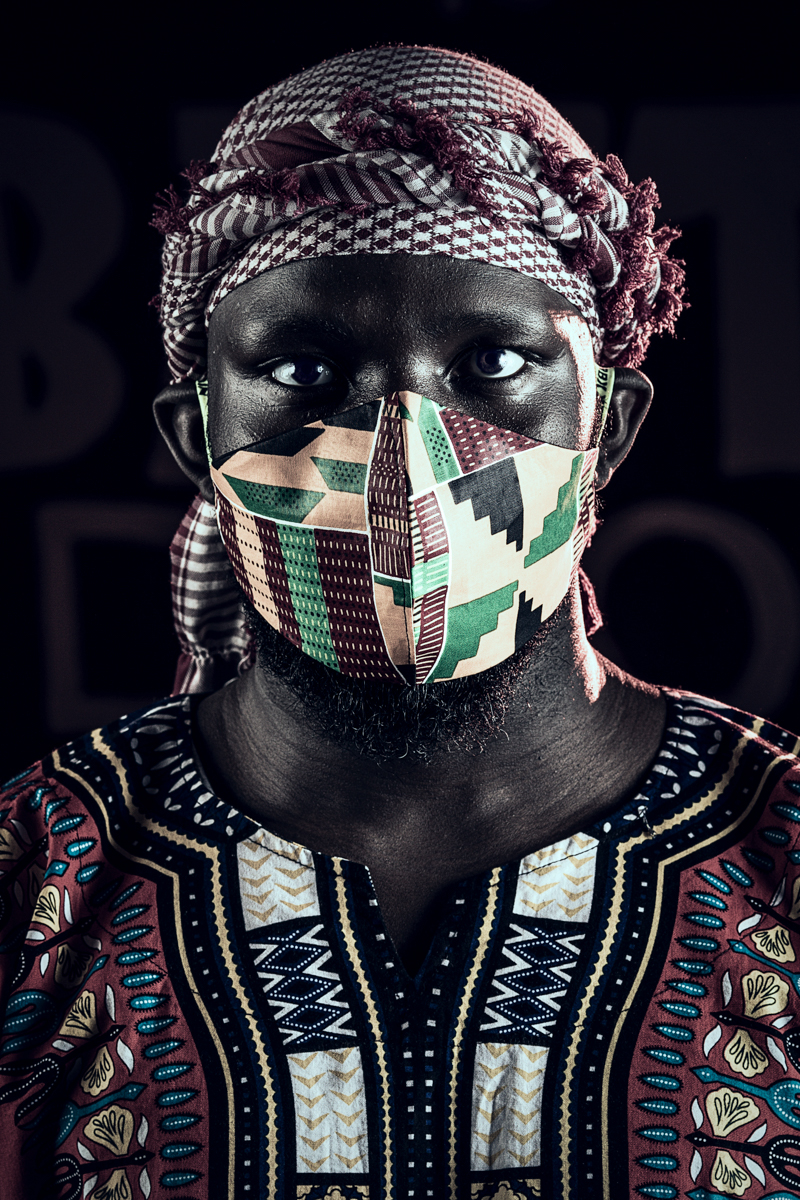 Isaya Evans on the Arafat scarf and african print mask