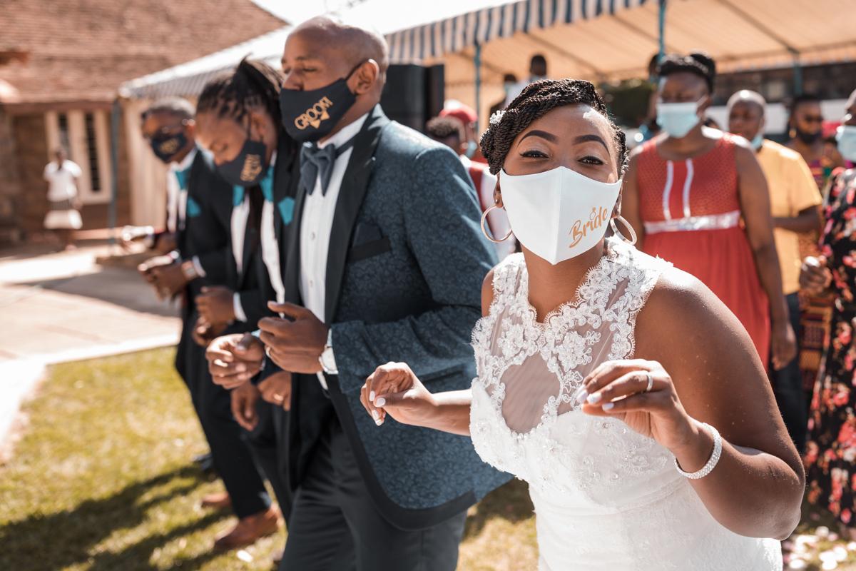 Covid 19 Coronavirus Lockdown Weddings Bride an Groom On Mask